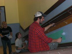A group of students painting a school