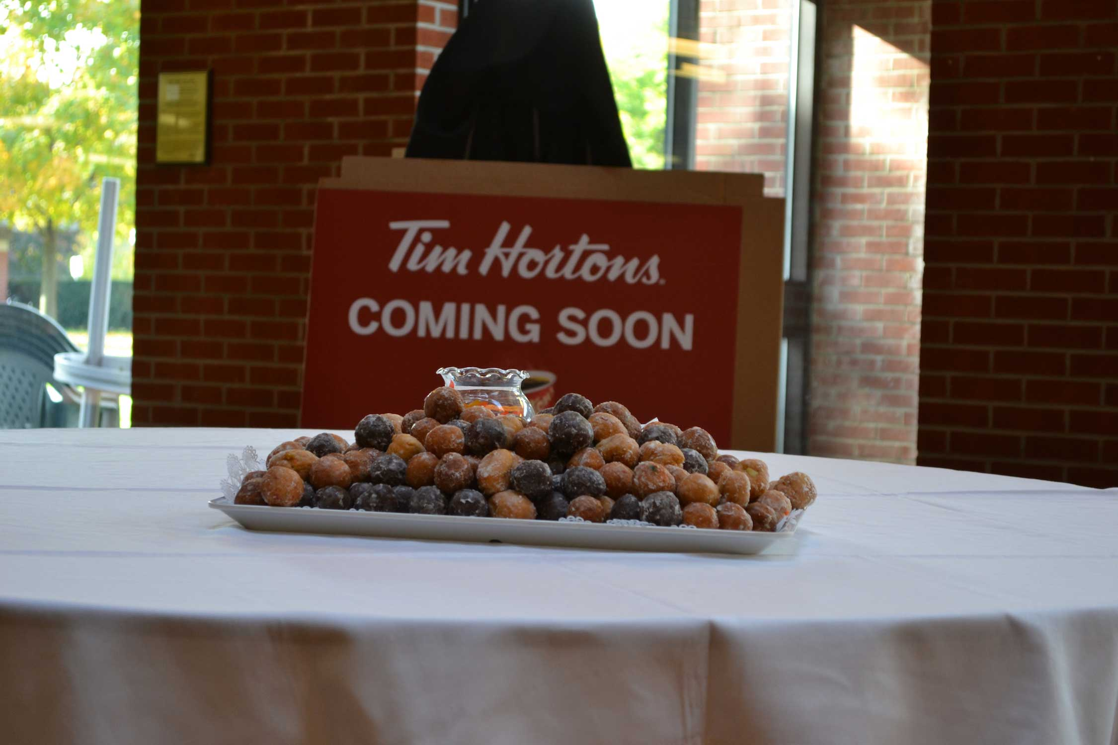 how to get tim hortons franchise